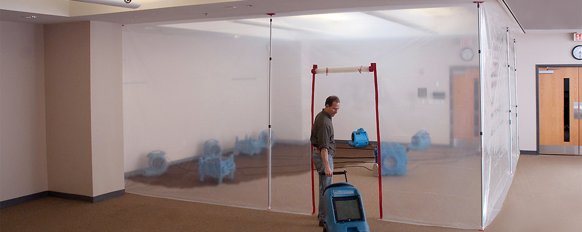 ZipWall 12 dust barrier poles in-use commercial